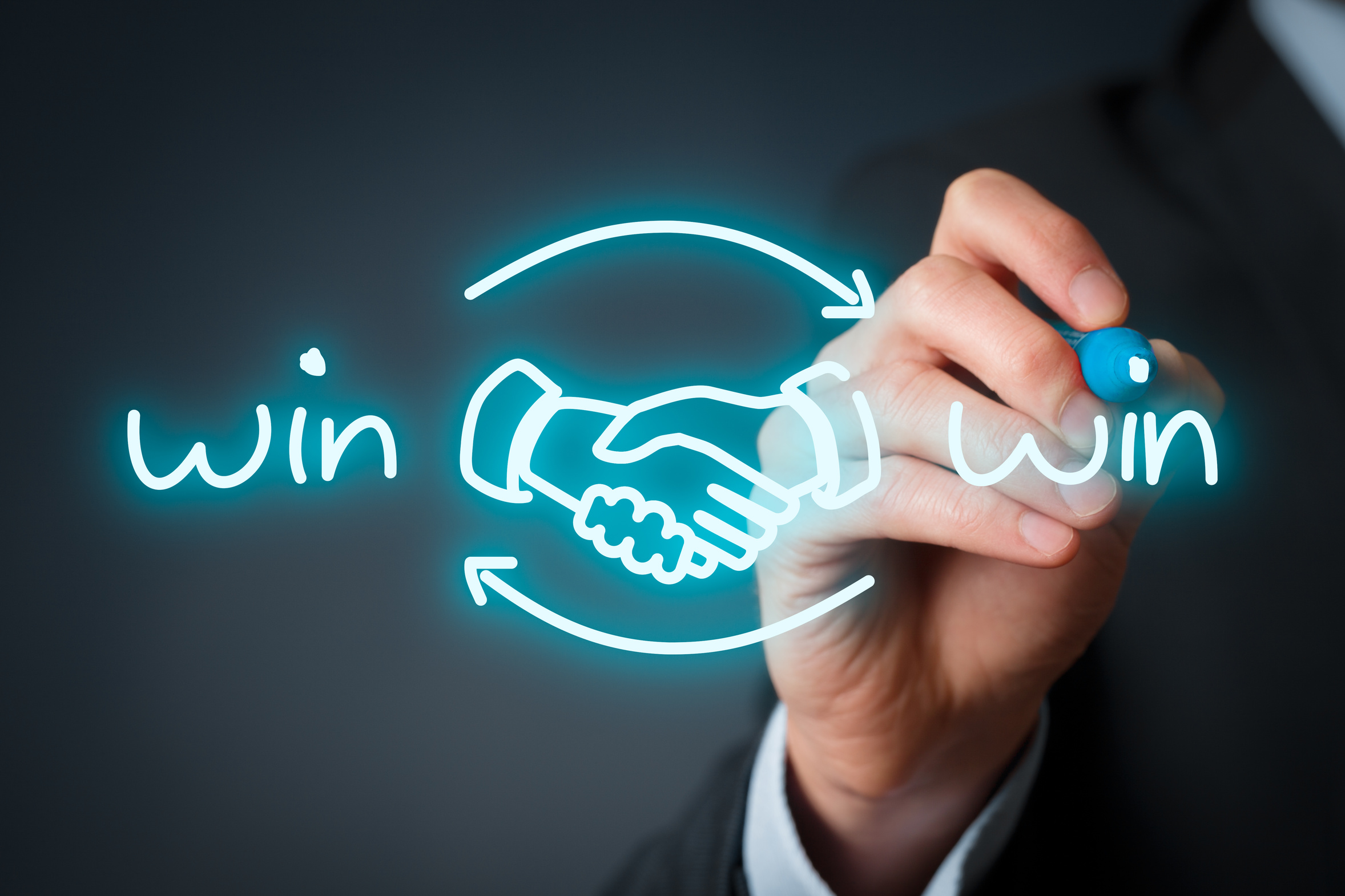 Win-win partnership strategy concept. Businessman draw win-win scheme with handshake partnership agreement.